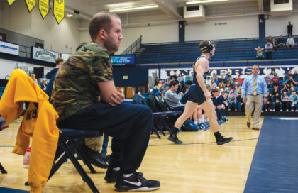 Driving Mr. Price: Longtime UCO Wrestling Manager Helps Motivate Team